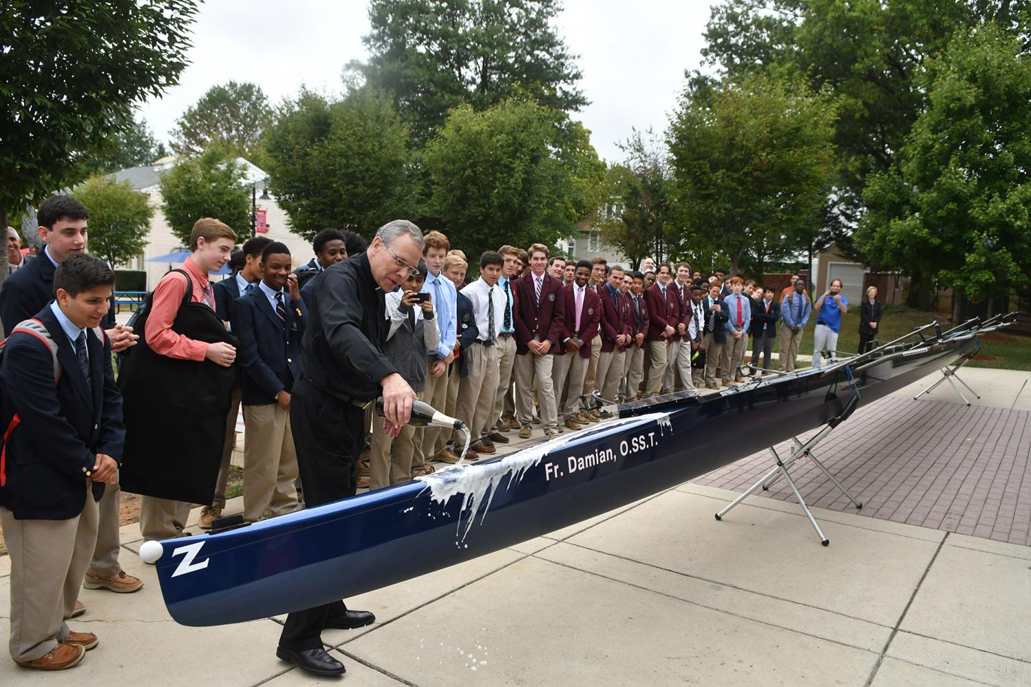 Father Damian christens new crew boat.