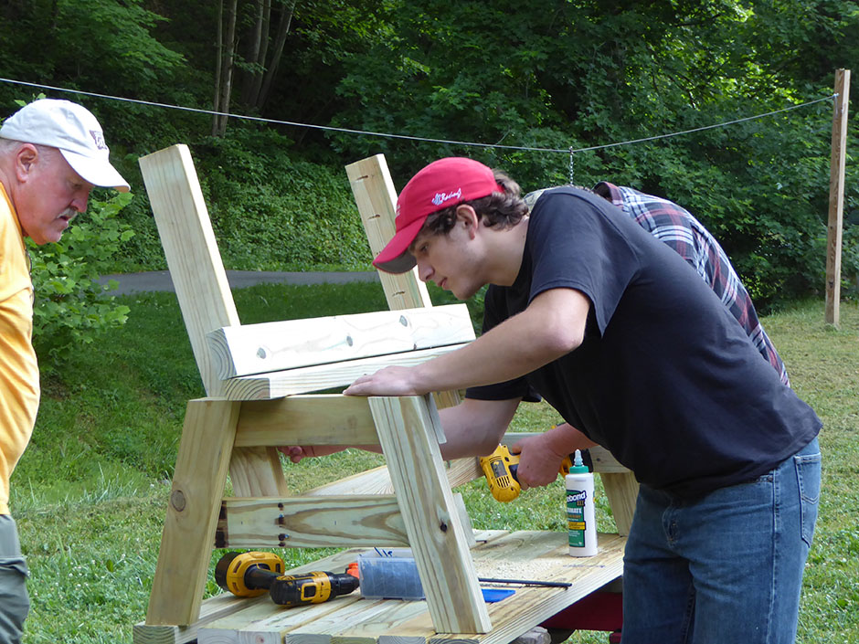 Chris Lucian shows off his craftsmanship and wood-working ability during Appalachian service trip.