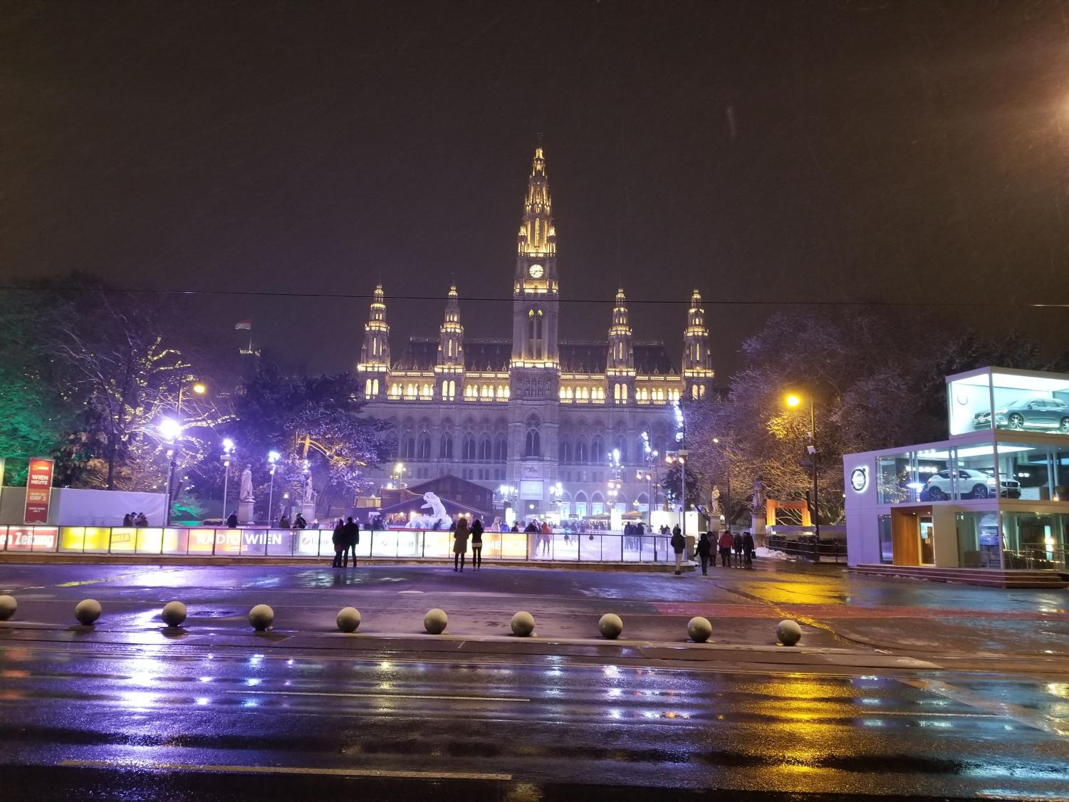 The Vienna city hall glows beautifully during a fun night of ice skating.