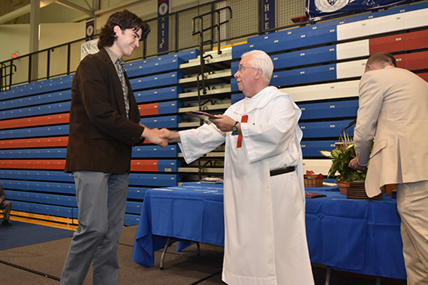 Father James gives Academic Award to Zach Misleh.