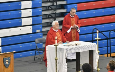 Father James and Father Damian celebrate opening school mass, emphasizing DeMatha's