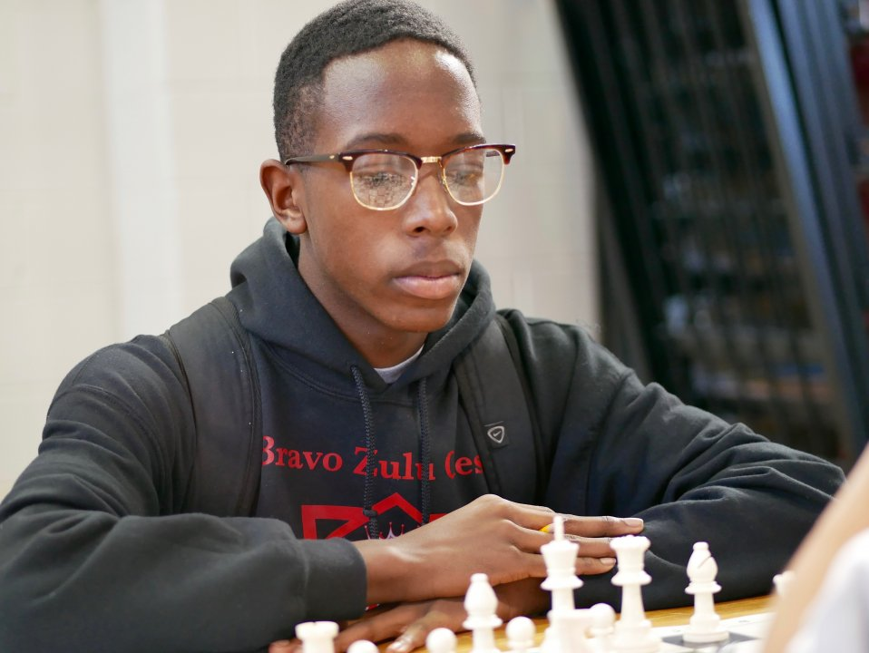 Zahir Muhammad concentrates on his chess match.