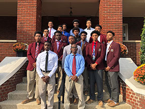 BSU members pose for a photo on the front steps of St. John DeMatha Hall.