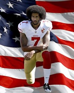Kaepernick kneels for the national anthem.
