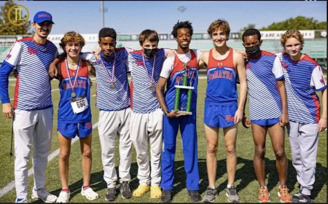 Tariq Lewis 22 (center holding trophy) pictured at Arundel High School with members of DeMathas Cross Country varsity squad. Photo credit to @demathaxc on Instagram and Antoine Keels 03.